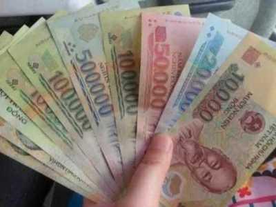 越南500万是多少人民币 中国人花500元人民币和越南人花500越南盾